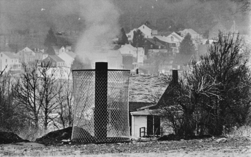 Rusty Kennedy  |  Associated Press file photo In this Jan. 26, 1983, file photo, smoke rises from the ground in Centralia, Pa., where and uncontrolled underground mine fire rages. Fifty years ago on May 27, a fire at the town dump spread to a network of coal mines underneath hundreds of homes and business in the northeastern Pennsylvania borough of Centralia, eventually forcing the demolition of nearly every building.