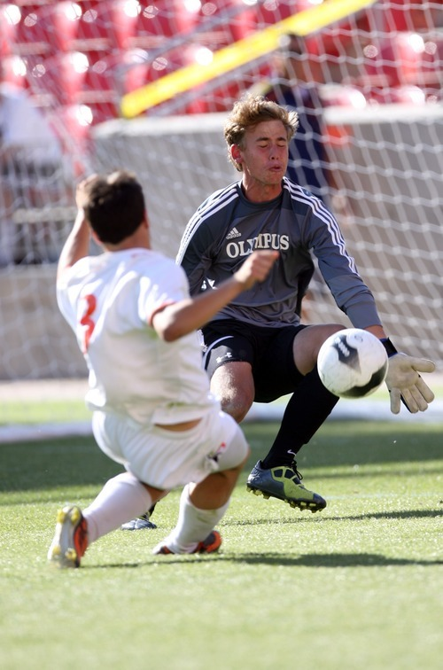 Kim Raff   The Salt Lake Tribune Olympus goalie Ethan Cash stops a shot by Murray player Alex Souvell during the 4A State Championship game at Rio Tinto Stadium in Sandy, Utah on May 24, 2012.  Olympus went on to win the game 3-2.