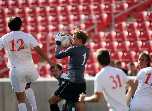 Kim Raff | The Salt Lake Tribune Olympus goalie Ethan Cash catches the ball during a Murray corner kick during the 4A State Championship game at Rio Tinto Stadium in Sandy, Utah on May 24, 2012. Olympus went on to win the game 3-2.