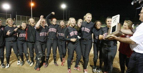 Paul Fraughton / Salt Lake Tribune Weber High school softball players celebrate as they are hande the 5A softball championship trophy.    Thursday, May 24, 2012