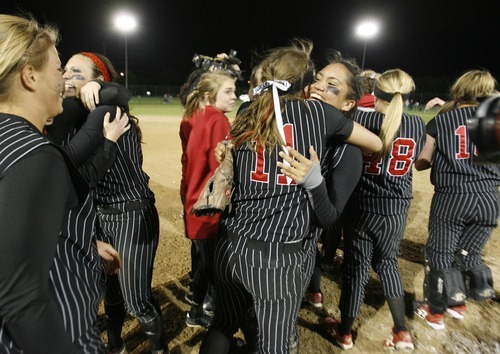 Paul Fraughton / Salt Lake Tribune Weber High school softball players celebrate their victory after defeating the Copper Hills High School team for the 5A  softball championship.   Thursday, May 24, 2012