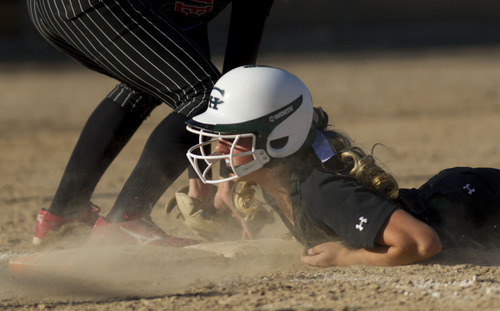 Trent Nelson  |  The Salt Lake Tribune Copper Hills' Riley Cleverly is picked off at first base by Weber's Hali Bennion during the state championship game on Thursday.