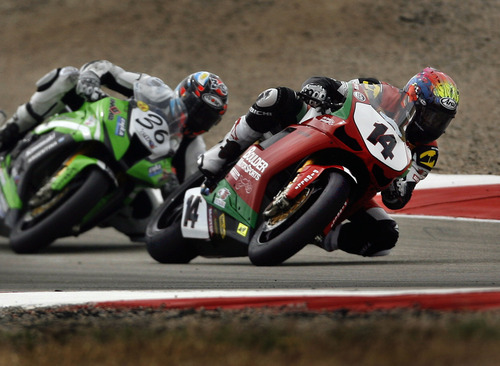 Scott Sommerdorf  |  The Salt Lake Tribune              Local rider Shane Turpin, #14 leads Leandro Mercado through The Attitudes during FIM Superbike World Championship Qualifying practice at Miller Motorsports Park, Saturday, May 26, 2012.
