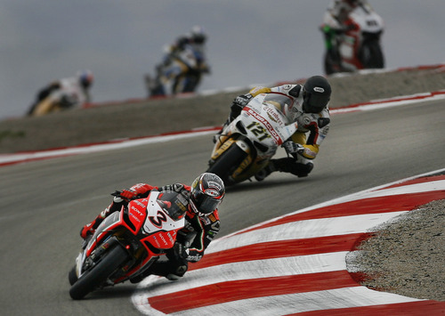 Scott Sommerdorf  |  The Salt Lake Tribune              Max Biaggi, #3, leads Maxime Berger, #121 through the Attitudes exit during FIM Superbike World Championship Qualifying practice at Miller Motorsports Park, Saturday, May 26, 2012.