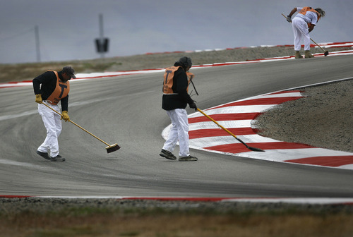 Scott Sommerdorf  |  The Salt Lake Tribune              Track crews clean the track prior to the afternoon's FIM Superbike World Championship Qualifying practice at Miller Motorsports Park, Saturday, May 26, 2012.