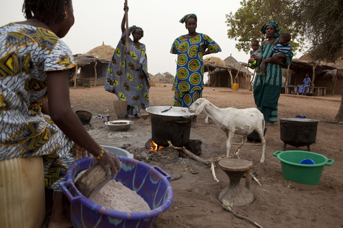 In this Monday, April 30, 2012 photo, women work together to prepare the evening meal, in the village of Fass, in the Matam region of northeastern Senegal. Since late 2011, aid groups have been sounding the alarm, warning that devastating drought has again weakened communities where children already live perilously close to the edge of malnutrition. The situation is most severe in Niger, Chad and in Mali, but this time it has also pervaded northern Senegal, the most prosperous and stable country in the Sahel. (AP Photo/Rebecca Blackwell)