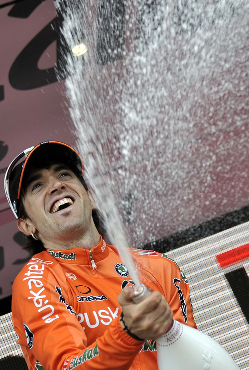 Spain's Jon Izaguirre sprays sparkling wine on the podium after winning the 16th stage of the Giro d'Italia, Tour of Italy cycling race, from Limone sul Garda to Falzes - Pfalzen, Italy, Tuesday, May 22, 2012. He finished in 4 hours and 2 minutes. His countryman Joaquin Rodriguez kept the overall lead. (AP Photo/Gian Mattia D'Alberto)