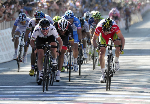 Britain's Mark Cavendish, left, crosses the finish line to win the fifth stage of the Giro d'Italia, Tour of Italy cycling race, from Modena to Fano, Italy, Thursday, May 10, 2012. World Champion Mark Cavendish won the fifth stage of the Giro d'Italia on Thursday, but there was more bad luck for Taylor Phinney as the American was caught up in another crash on the 199-kilometer leg from Modena to Fano. (AP Photo/Gian Mattia D'Alberto)
