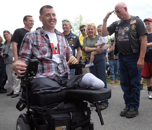 FILE - In this Saturday, April 21, 2012 file photo, U.S. Army Sgt. Adam Keys, left, who was wounded in Afghanistan in 2010, is greeted by hundreds of community members during a homecoming ceremony at Cementon Park in Whitehall Township, Pa. A staggering 45 percent of the 1.6 million veterans from the wars in Iraq and Afghanistan are now seeking compensation for disabilities they say are service-related - more than double the 21 percent who filed such claims after some previous wars, according to top government officials. The new veterans have different types of injuries than previous veterans did, in part because improvised bombs have been the main weapon and because body armor and improved battlefield care allowed many of them to survive wounds that in past wars proved fatal. (AP Photo/The Express-Times, Matt Smith, File)