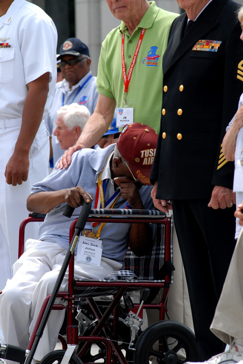 This handout photo provided by Laura Sikes, taken, Wednesday, May 23, 2012, shows an emotional Air Force Lt. Col. Julius Jackson, 91, of Chicago, who flew a B-51 Mustang with the Tuskegee Airmen's 332nd fighter group, cries during a ceremony honoribg World War II veterans at the the World War II Memorial in Washington.  (AP Photo/Laura Sikes)
