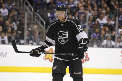 Los Angeles Kings center Trevor Lewis (22) readies for a face-off against Vancouver Canucks during the first period of Game 3 in a first-round NHL Stanley Cup playoff series in Los Angeles, Sunday, April 15, 2012.  (AP Photo/Alex Gallardo)