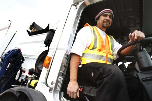 Leah Hogsten  |  The Salt Lake Tribune Salt Lake County sanitation employee Saul Lopez picks up recycling Friday, May 25, 2012, in Kearns. Lopez is the recipient of a national Driver of the Year award.