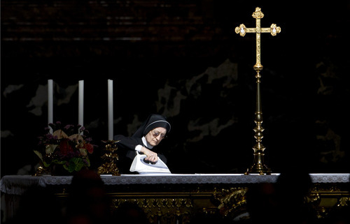 A nun irons a secondary altar prior to the arrival of Pope Benedict XVI to celebrate a Pentecost Mass inside St. Peter's Basilica, at the Vatican, Sunday, May 27, 2012. (AP Photo/Andrew Medichini)