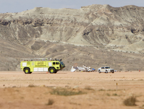Samantha Clemens | The Spectrum Emergency officials respond to a fatal plane crash near the St. George Municipal Airport on Saturday, May 26, 2012. The National Transportation Safety Board and Federal Aviation Association are investigating. The Cessna 172 single-engine fixed-wing airplane crashed about 300 feet south of the airport's runway.