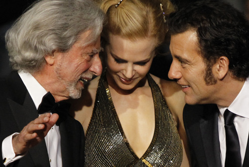 From left, director Phillip Kaufman, actors Nicole Kidman and Clive Owen interact as they arrive for the screening of Hemingway and Gellhorn at the 65th international film festival, in Cannes, southern France, Friday, May 25, 2012. (AP Photo/Joel Ryan)
