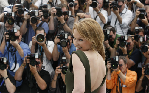 Actress Kylie Minogue poses during a photo call for Holy Motors at the 65th international film festival, in Cannes, southern France, Wednesday, May 23, 2012. (AP Photo/Lionel Cironneau)