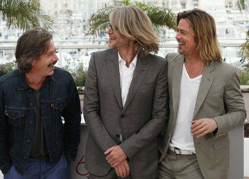 Actor Ben Mendelsohn, left, director Andrew Dominik and actor Brad Pitt poses during a photo call for Killing Them Softly at the 65th international film festival, in Cannes, southern France, Tuesday, May 22, 2012. (AP Photo/Lionel Cironneau)