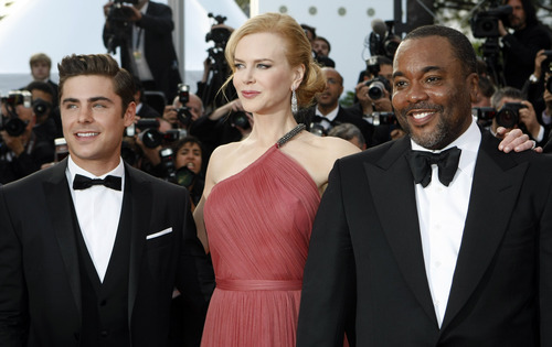 From left, actors Zac Efron, Nicole Kidman and director Lee Daniels arrive for the screening of The Paperboy at the 65th international film festival, in Cannes, southern France, Thursday, May 24, 2012. (AP Photo/Lionel Cironneau)