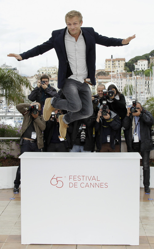 Actor Jeremie Renier poses during a photo call for White Elephant at the 65th international film festival, in Cannes, southern France, Monday, May 21, 2012. (AP Photo/Francois Mori)