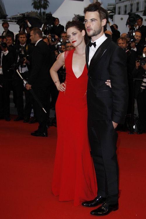 Actors Kristen Stewart, left, and Tom Sturridge arrive for the screening of Cosmopolis at the 65th international film festival, in Cannes, southern France, Friday, May 25, 2012. (AP Photo/Joel Ryan)