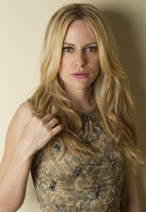 Model for L'Oreal, Aimee Mullins poses during a photo session at the 65th international film festival, in Cannes, southern France, Friday, May 25, 2012. (AP Photo/Joel Ryan)