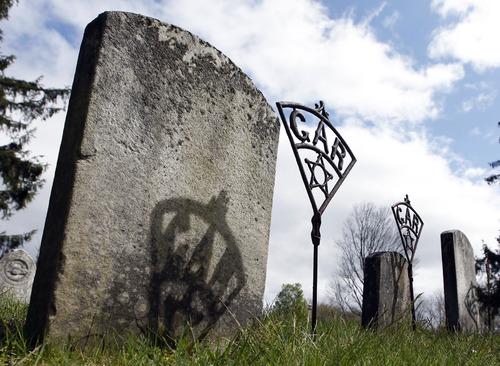 In this April 27, 2012 photo, markers with the letters GAR, which stands for Grand Army of the Republic, stand by the grave sites of soldiers who served in the Civil War at Prospect Hill Cemetery in Guilderland, N.Y.  Nearly 150 years after the last fusillade of the Civil War, historians, authors and museum curators are still finding new topics to explore as the nation commemorates the sesquicentennial of America's bloodiest conflict. Even the long-accepted death toll of 620,000, cited by historians since 1900, is being reconsidered. In a study published late last year in Civil War History, Binghamton University history demographics professor J. David Hacker said the toll is actually closer to 750,000. (AP Photo/Mike Groll)