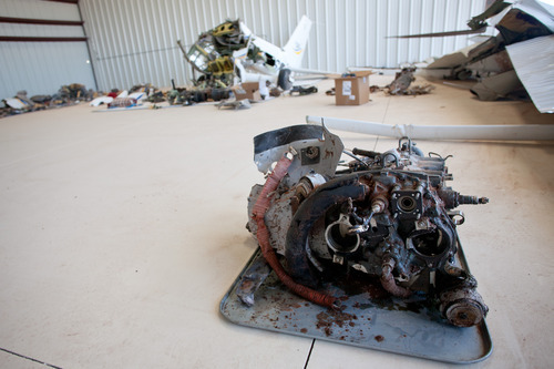 Jud Burkett | The Spectrum The wreckage of a single engine plane that crashed early Saturday morning near the St. George Airport lies in a hangar at the airport as the investigation into the cause of the crash in which four people were killed continues Monday, May 28, 2012.