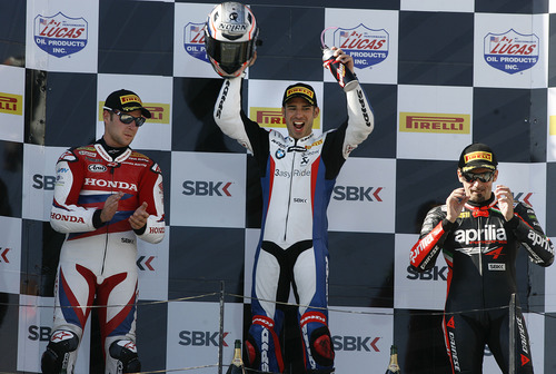 Scott Sommerdorf  |  The Salt Lake Tribune              BMW driver Marco Melandri, center,  won FIM Superbike World Championship Race Two, Monday, May 28, 2012. At left is second place finisher Jonathan Rea, and at right is Max Biaggi who took third place.