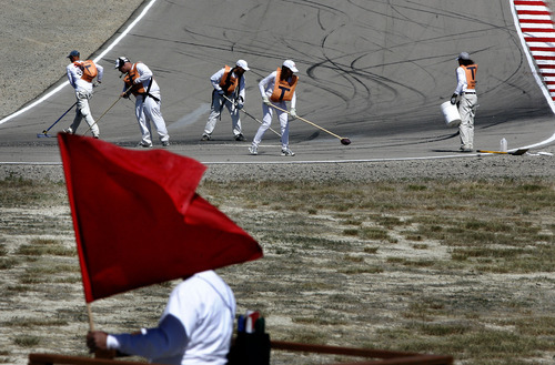 Scott Sommerdorf     The Salt Lake Tribune              Under a red flag, it took 90 minutes for track crews to clean up the mess caused by Hiroshi Aoyama's crash on lap 3 at The Attitudes turns. After the restart, BMW driver Marco Melandri won FIM Superbike World Championship Race Two, Monday, May 28, 2012.