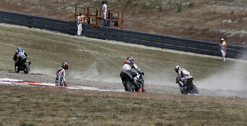 Scott Sommerdorf     The Salt Lake Tribune              Riders scramble to avoid a fallen Hiroshi Aoyama (second from left) after he crashed his racing bike at The Attitudes on lap 3. The crash caused a 90 minute delay for crews to make the track safe again. BMW driver Marco Melandri won FIM Superbike World Championship Race Two, Monday, May 28, 2012.