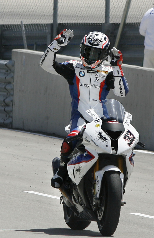 Scott Sommerdorf  |  The Salt Lake Tribune              BMW rider Marco Melandri waves to the crowd as he enters the winner's area after placing second behind Carlos Chace in FIM Superbike World Championship Race One, Monday, May 28, 2012.