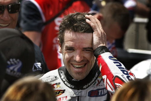 Scott Sommerdorf     The Salt Lake Tribune              Carlos Checa reacts after winning the FIM Superbike World Championship Race One, Monday, May 28, 2012. Marco Melandri was second, and Max Biaggi third.