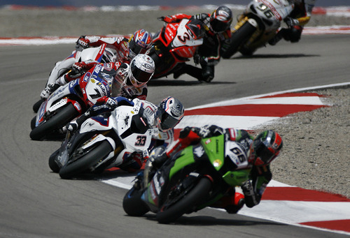 Scott Sommerdorf     The Salt Lake Tribune              The top three finishers in the FIM Superbike World Championship Race One are seen here during a turn in The Attitudes. Winner Carlos Checa, #7, Second place finisher Marco Melandri, #33, and #3 Max Biaggi finishing third, Monday, May 28, 2012.