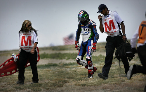 Scott Sommerdorf     The Salt Lake Tribune              Josh Hopkins walks with Medical personnel after he crashed his bike on the 7th lap at the top of the first Attitude turn during FIM Superbike World Championship Race One, Monday, May 28, 2012. He appeared to be unhurt, but retired from the race.