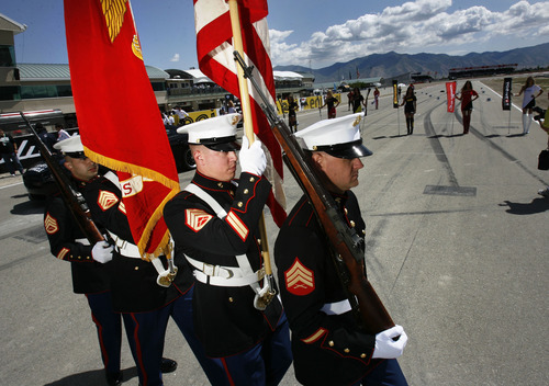 Scott Sommerdorf     The Salt Lake Tribune              A Marine color guard presented the colors during the opening ceremonies prior to FIM Superbike World Championship Race One, Monday, May 28, 2012.