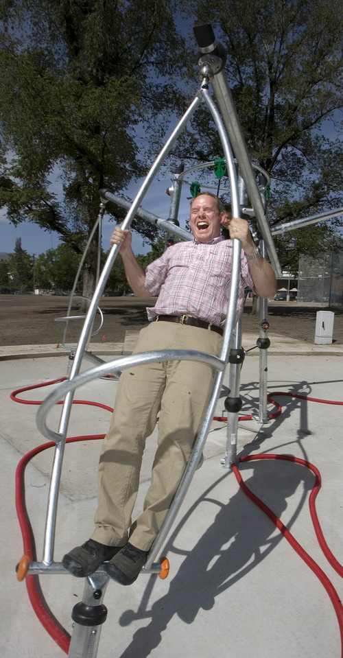 Paul Fraughton | Salt Lake Tribune Morgan Selph, a landscape architect for Salt Lake County Parks and Recreation, enjoys playing on the electronic jungle gym at Evergreen Park.