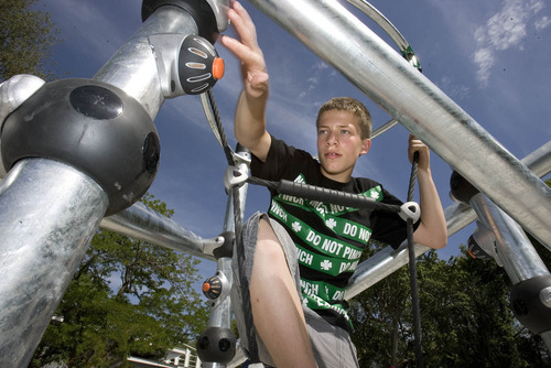 Paul Fraughton | Salt Lake Tribune Soren Selph, age 12, plays recently on a high-tech electronic jungle gym that uses  LED lights and computer-generated games. The  jungle gym, along with other electronic feature,s will be  part of the  remodeled  playground  at  Evergreen Park.