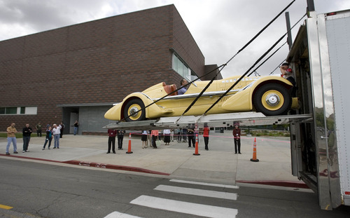 Paul Fraughton | Salt Lake Tribune John Carefoot sits inside the Mormon Meteor I  as it is lowered to the ground in front of the  Utah Museum of Fine Arts in Salt Lake City on Wednesday, May 23, 2012. The car is one of 19 classic cars that will be featured in an upcoming exhibit at the museum.