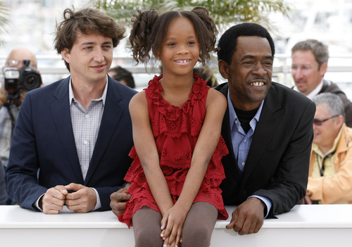 Director Benh Zeitlin, left and actors Quvenzhane Wallis and Dwight Henry pose during a photo call for Beasts of the Southern Wild at the 65th international film festival, in Cannes, southern France, Saturday, May 19, 2012. (AP Photo/Lionel Cironneau)