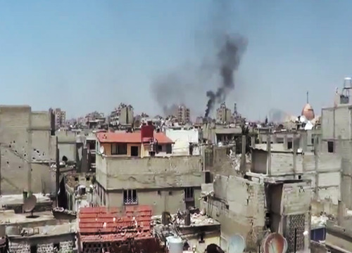 In this image made from amateur video released by the Shaam News Network and accessed Monday, May 28, 2012, purports to show black smoke rising from buildings in Homs, Syria. U.N. envoy Kofi Annan called Monday on