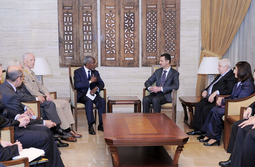 This photo dated Tuesday, May 29, 2012 released by the Syrian official news agency SANA shows UN-Arab League Joint Special Envoy for Syria (JSE) Kofi Annan, fourth left, Norwegian Maj. Gen. Robert Mood, head of the U.N. observer team in Syria, third left, Syrian President Bashar Assad, third right, and Syrian Foreign Minister Walid Moallem, second right, attend a meeting in Damascus, Syria. International envoy Kofi Annan met Syrian President Bashar Assad on Tuesday following a massacre last week that killed more than 100 people and sparked widespread international condemnation against Damascus. (AP Photo/SANA)
