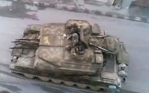 In this image made from amateur video released by the Shaam News Network and accessed Monday, May 28, 2012, purports to show a Syrian military tank in Damascus, Syria. U.N. envoy Kofi Annan called Monday on