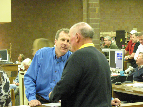 Donald W. Meyers | Tribune file photo State Rep. Chris Herrod, R-Provo, speaks with a participant in a caucus at Timpview High, where many moderates were elected delegates -- as they were around the state.
