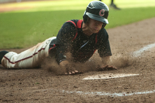 Chris Detrick  |  The Salt Lake Tribune American Fork's Cade Hill (22) dives safely to home base during the 5A championship game at Kearns High School Friday May 25, 2012.  American Fork won the game 5-4.