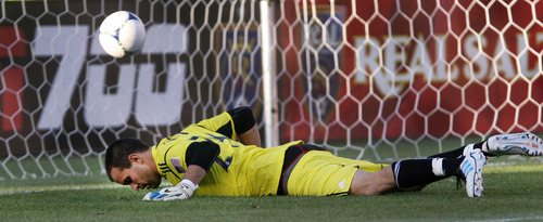 Steve Griffin | The Salt Lake Tribune Real Salt Lake goal keeper Kyle Reynish lays on the turf as the ball bounces in the net after Minnesota scored on a penalty kick in the first half of their game at Rio Tinto Stadium in Sandy on May, 29, 2012.