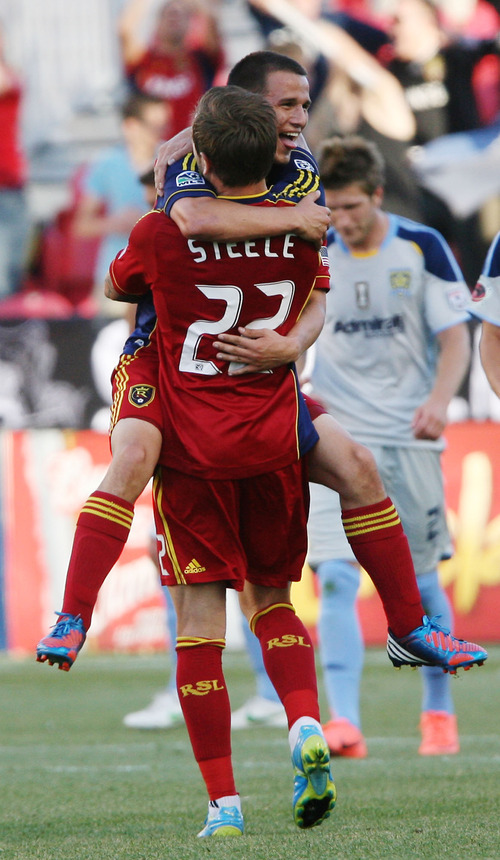 Steve Griffin | The Salt Lake Tribune Real Salt Lake's Luis Gill leaps into the arms of Johnny Steele after scoring a goal against Minnesota in the first half of their game at Rio Tinto Stadium in Sandy on May, 29, 2012.