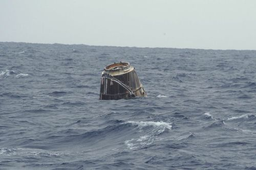 The Dragon capsule floats in the ocean as it awaits recovery. Photo courtesy SpaceX