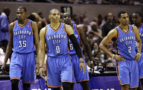Oklahoma City Thunder's Kevin Durant (35), Russell Westbrook (0), Kendrick Perkins (5), Thabo Sefolosha (2) and Serge Ibaka (9) react against the San Antonio Spurs during the second half of Game 2 in their NBA basketball Western Conference finals playoff series, Tuesday, May 29, 2012, in San Antonio. (AP Photo/Eric Gay)