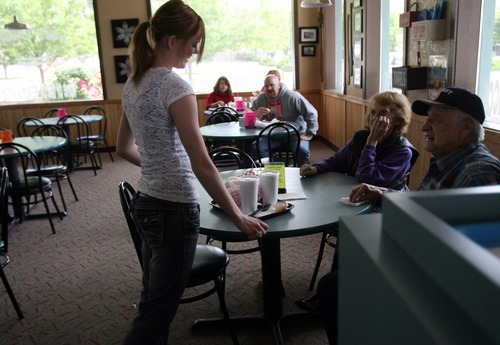 Kim Raff | The Salt Lake Tribune Waitress Fancy Fors delivers food to customers at Dairy Delight in Tooele.