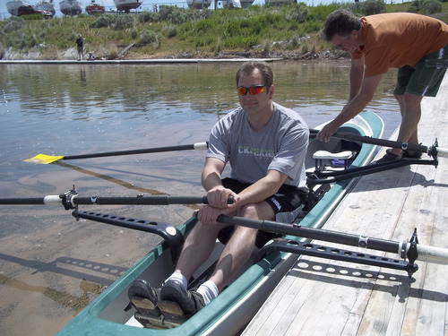 Glenn Eurick (in orange), a member of the Great Salt Lake Rowing Club, takes a new rower out into the water in last year's Learn to Row day. The annual event is Saturday, June 2. Courtesy photo
